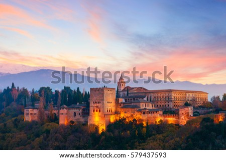 Shutterstock View of the famous Alhambra palacein Granada with Sierra Nevada mountains at the background, Spain