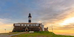View of the famous Barra Lighthouse in Salvador, Bahia during sunset in summer in northeast Brazil