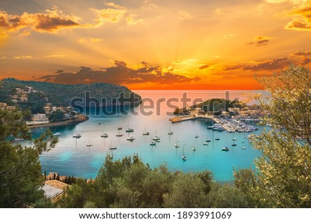 View of the famous Soller Port Marina and Dockland illuminated by sunset light in Palma de Majorca in Spain in summer season