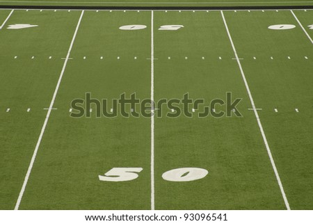 View of the fifty yard line on an American football field - stock photo