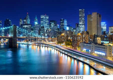 View of the financial district of Manhattan at night in New York City.
