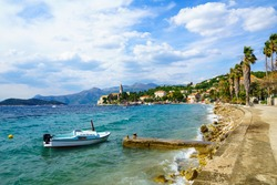 View of the fishing port and the beach, with cafes, boats, in the village Lopud, Lopud Island, one of the Elaphiti Islands, Croatia