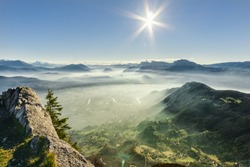 View of the foggy green valley in French Alps near Grenoble