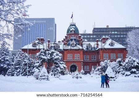 View of the Former Hokkaido Government Office in Sapporo, Hokkaido, Japan. Traveler take a photo at the Former Hokkaido Government Office in Sapporo, Hokkaido, Japan in winter