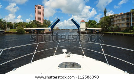View of the Fort Lauderdale Intracoastal Waterway from a yacht with a drawbridge ahead