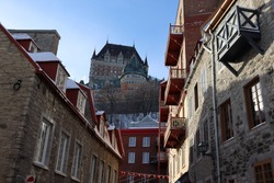 View of the frontenac castle of the lower town in the old quebec with a blue sky