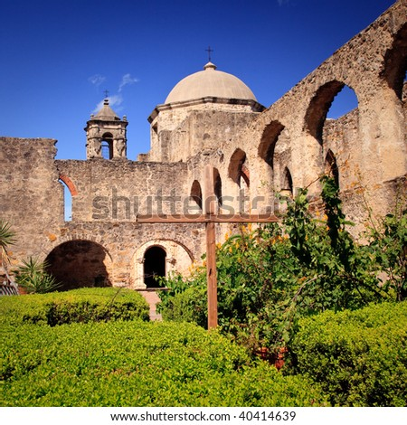 View of the garden and cross in front of the San Juan Mission  near San Antonio in Texas