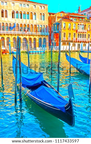 View of The Grand Canal in Venice with moored gondolas in the evening, Italy
