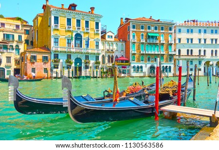 View of The Grand Canal in Venice with moored gondolas on a sunny day, Italy