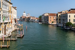 View of the Grand Canal with close up of Santa Maria della Salute, famous Roman Catholic cathedral, seen from Ponte Dell'Accademia