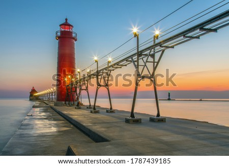 View of the Grand Haven South Pierhead Inner and Outer Lighthouses at sunset; Grand Haven State Park, Lake Michigan Сток-фото ©