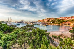 View of the harbor with luxury yachts of Porto Cervo, Sardinia, Italy. The town is a worldwide famous resort and a luxury yacht magnet and billionaires' playground