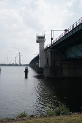 View of the Haringvliet bridge with wind mills in the Netherlands. Connection from Brabant to South Holland.