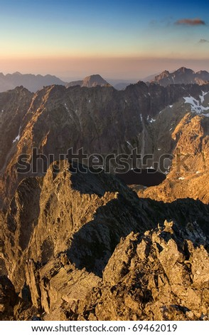 View of the high mountains and lake. Last rays of the sun in Slovakian Tatras.