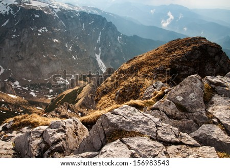 View of the high mountains with rocks on the foreground. Last rays of the sun in tatras #156983543