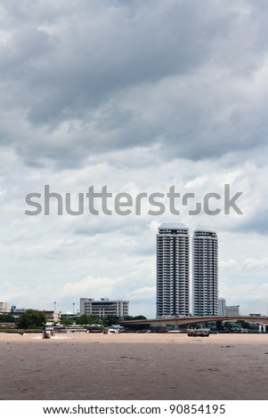 view of the Highrise building ,Rama VIII Bridge from the Chao Praya river