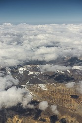 View of the Himalayas mountain range from the airplane window. New Delhi-Leh flight ,India.
