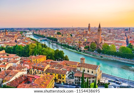 View of the historic city center along Adige river at sunset in Verona, Italy.