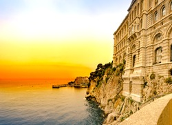 View of the historic stone colorful building Oceanographic Museum on a background of sunset sky. Monte Carlo, Monaco