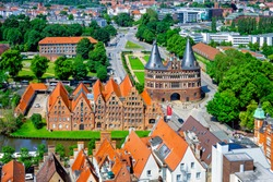 View of the historic town of Lubeck with famous Holstentor gate in summer, Schleswig-Holstein, northern Germany