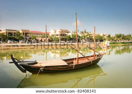 View of the Hoi An old town from the Thu Bon River. Boat in the foreground. Vietnam