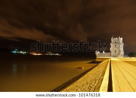 view of the illuminated Torre de Belem in Lisbon at night