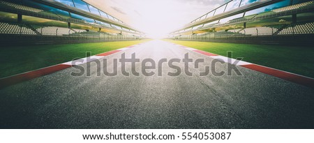 View of the infinity empty asphalt international race track, digital imaging retouch and  montage background . evening scene . - Shutterstock ID 554053087