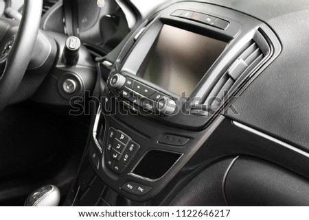 View of the interior of a modern automobile showing the dashboard #1122646217