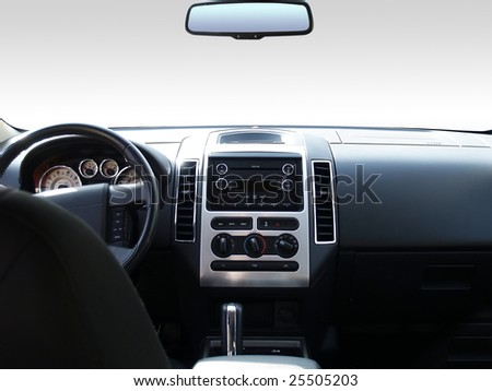 View of the interior of a modern automobile showing the dashboard and rear view mirror. A clipping path of the windshield and mirror are included so you can replace it with whatever you like!