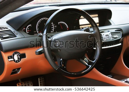 View of the interior of a modern automobile showing the dashboard. Car interior luxury service. Car interior details #536642425