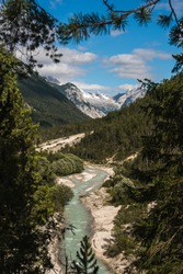 View of the Isar River close to Scharnitz village, austrian Alps, during the summer, Europe