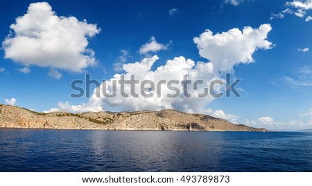view of the island in Aegean sea, clouds, Sunny summer day #493789873