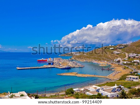 view of the island to the port, sea and sky with clouds. Greece, Mykonos.