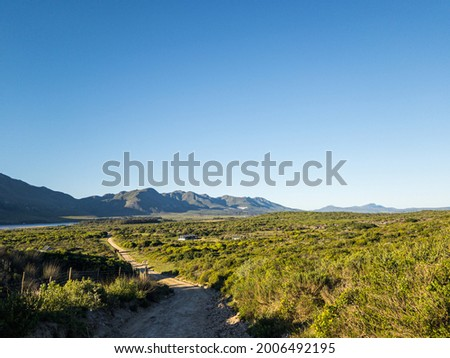View of the Klein River and Kleinrivier Mountains near Stanford, Whale Coast, Overberg, Western Cape. South Africa. Stockfoto ©