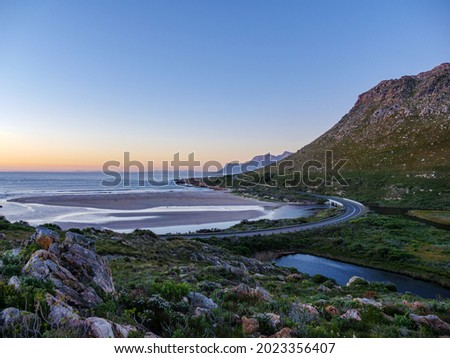 View of the Kogelberg Mountains  and the Rooi-Els Estuary along Clarence Drive between Gordon's Bay and Rooi-Els. False Bay. Western Cape. South Africa Stock fotó ©