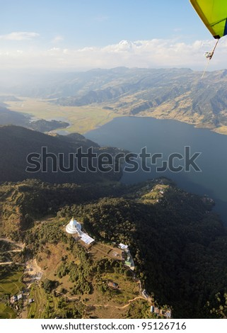View of the lake and the buddhist stupa from motor hang-glider - Pokhara, Nepal