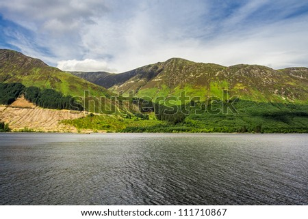 View of the lake in the mountains in Scotland in the summer