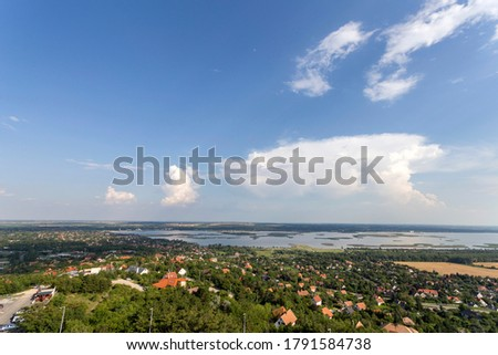 View of the lake Velence, Hungary from the look-out tower at Bence hegy on a summer day. Stock fotó ©