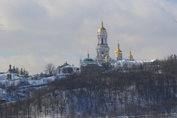View of the large bell tower and other churches in the Kyivo-Pecherska Lavra. Kyiv. Ukraine. Kyivo-Pechersky Monastery. Winter sunny day.