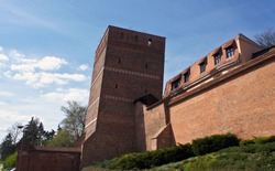 View of the Leaning Tower (Krzywa Wieża), old town, beautiful architecture, sunny day, Medieval Defensive City Walls, Torun, Poland