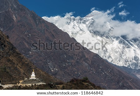 View of the Lhotse (8516 m) and Buddhist stupa from the trek to Namche Bazar - Nepal, Himalayas