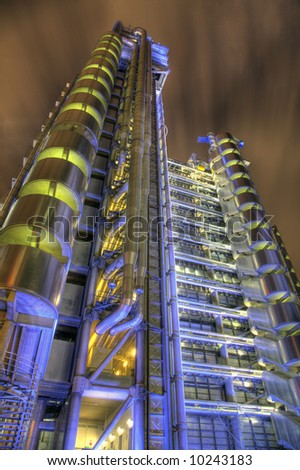 View of the Lloyds Building at One Lime Street in the City of London. Detailed night-time HDR image.