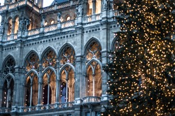 View of the main Christmas tree and the arch of the Town Hall on Rathaus Square.