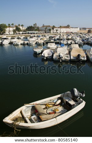 View of the marina with traditional fishing boats on Faro,  Portugal.