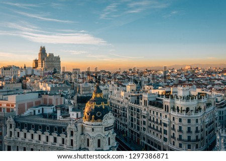 View of the Metropolis Building and Gran Via from the Circulo de Bellas Artes rooftop at sunset, in Madrid, Spain #1297386871