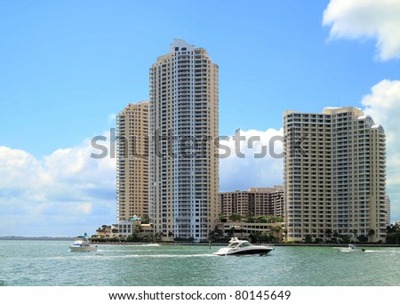 View of the Miami inlet with pleasure boats and downtown Apartments.