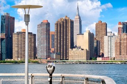 View of the midtown Manhattan skyline in New York on a beautiful summer day from a pier in Queens
