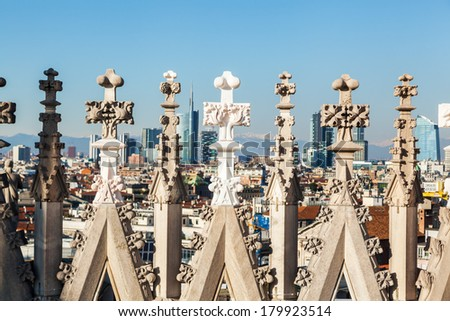 view of the Milan skyline through architectural details of the Milan Cathedral with focus on the foreground