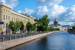 View of the Moika, GUAP and St. Isaac's Cathedral from the Kiss Bridge. Sky with cumulus clouds