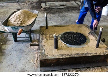 View of the mold of the steel casting. Sand castings are produced in specialized factories called foundries.